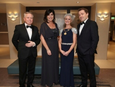 Paul McDonnell (left) with Aine Myler, Carol Solan and Ardal O'Hanlon, pictured at the Society of Chartered Surveyors Ireland Annual Dinner 2017 held in the Clayton Hotel, Dublin.