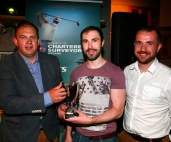 Kevin Coen accepting the winners trophy on behalf of Vincent Finnegan